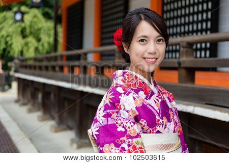 Young woman with Kimono in Temple