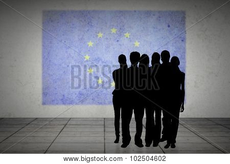 Silhouette of team of people against eu flag