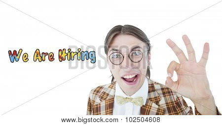 Geeky hipster doing the ok sign against we are hiring