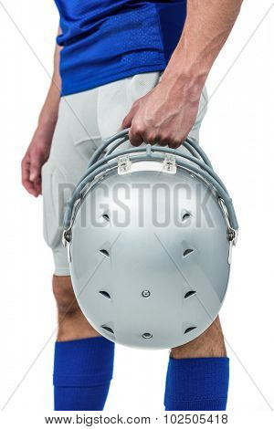 Sports player handing his helmet on a white background