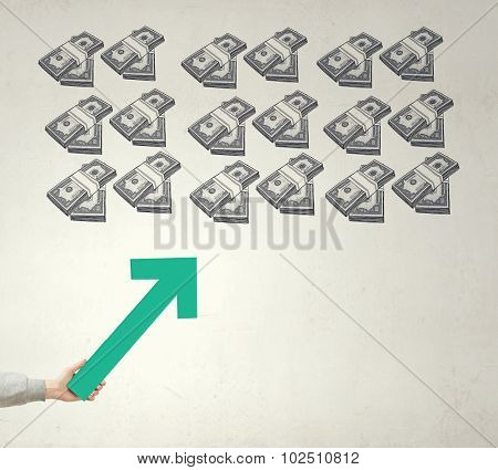 Hand holding rising arrow representing business growth