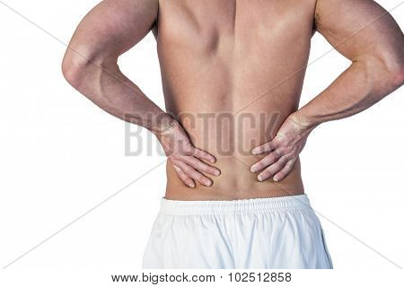 Midsection of man undergoing back pain over white background