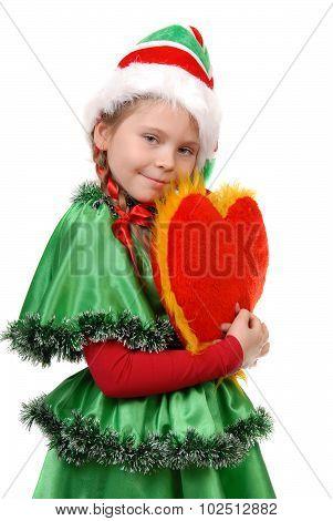 Girl in suit Santa's elf holds heart.