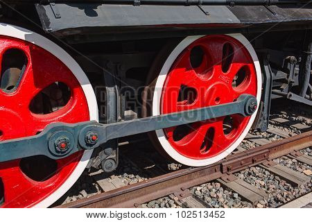 Old steam locomotive painted wheels