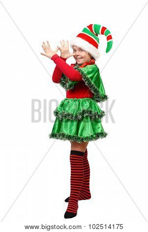 Girl In A Dress Of The Christmas Elf Shows Teasing