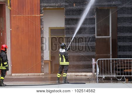 Firefighters Extinguished The Fire In The Building