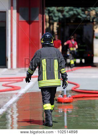 Isolated Italian Fireman With Protective Uniform And Helmet