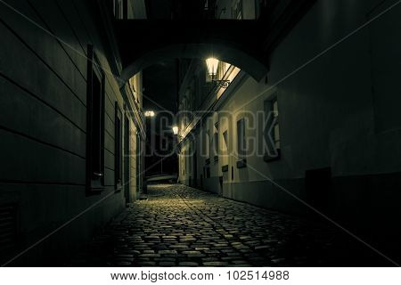 mysterious alley with lanterns in Prague at night
