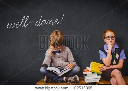 The word well-done! and pupils studying against blackboard