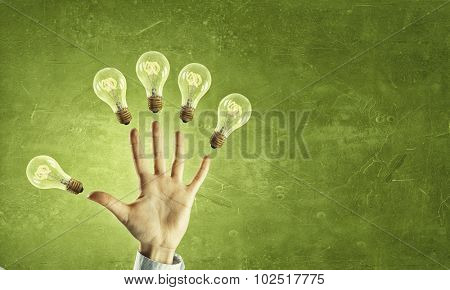 Hand showing fife and light bulbs on each finger