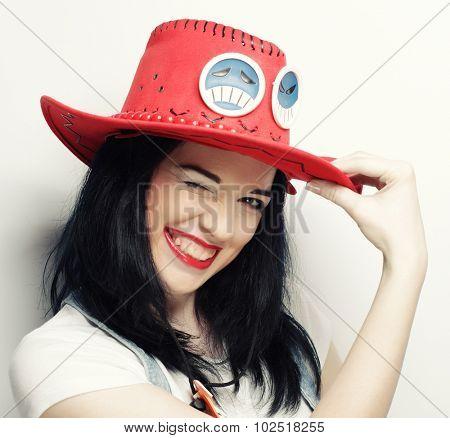 Portrait of Trendy Hipster Girl in Red Hat, studio shot