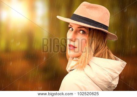 Pretty hipster blonde against autumn scene