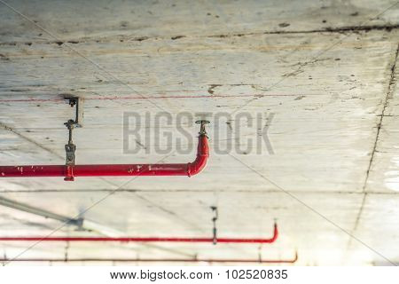 Fire sprinkler and red pipe  ( Filtered image processed vintage effect. )