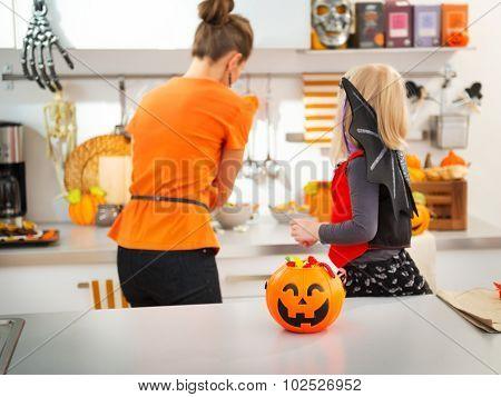 Closeup On Halloween Pumpkin Bucket Full Of Candy On Table