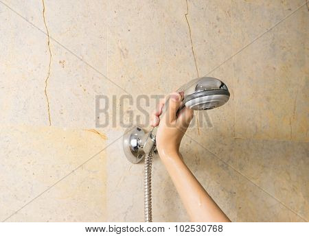 Hand Holds A Shower On Marble Background