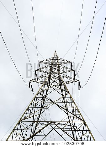 Transmission tower against a cloudy sky background