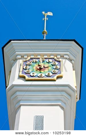Tower With Mosaic Clock And Weathercock