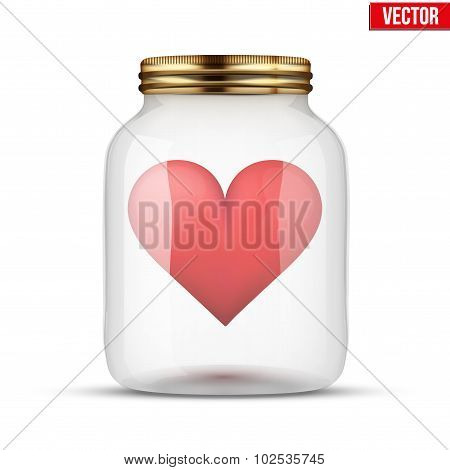 Red heart inside glass jar.