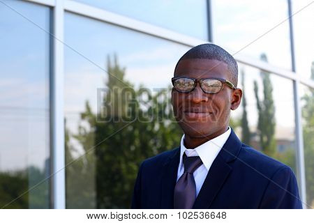 Handsome African American businessman near business centre