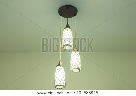 Lamps With Glass Structure On Ceiling In Ballroom