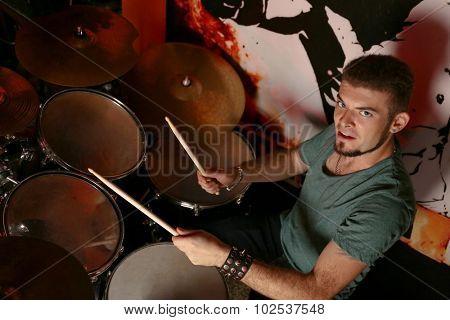Drummer on dark background