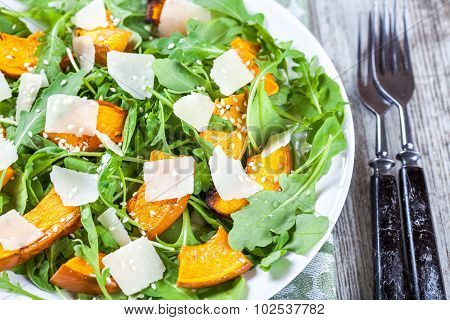 Salad With Baked Pumpkin, Arugula, Parmesan And Sesame