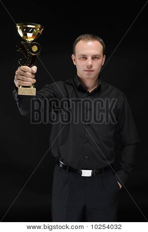 Businessman With Win Cup In Hand