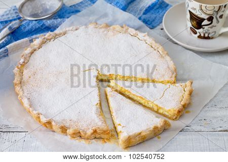 Cheesecake With Cream Cheese, Puff Pastry On A White Wooden Table