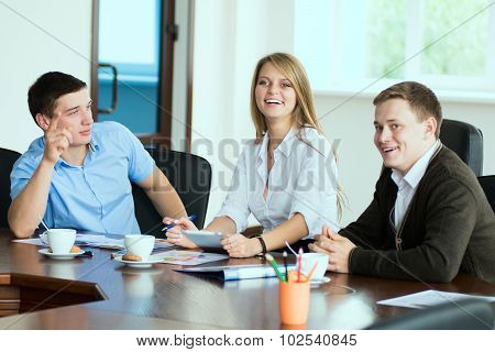 Young Business Woman With Business Partners, Men At A Business Meeting.