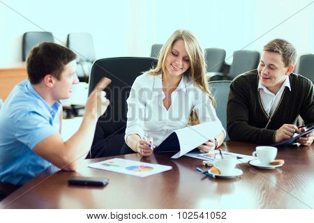 Young Business Woman With Business Partners, Men At A Business Meeting