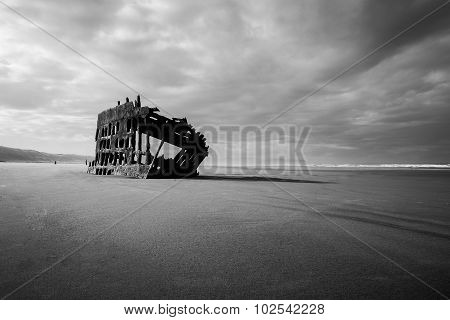 Black and White landscape of a shipwreck on a beach