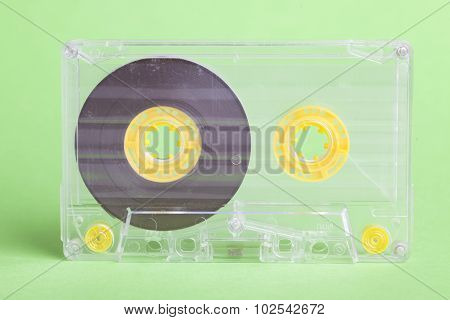 Audio Cassette On Green Background
