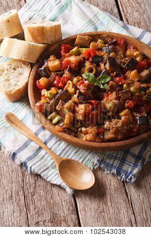 Sicilian Cuisine: Caponata With Aubergines Close-up. Vertical, Rustic