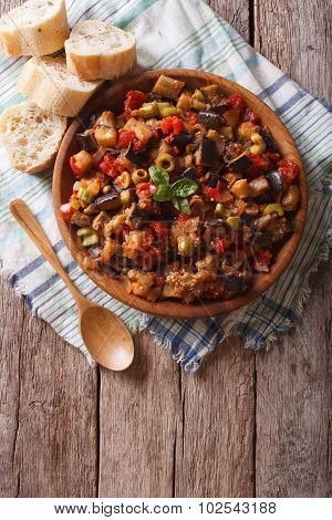 Caponata With Aubergines In A Wooden Plate. Vertical Top View