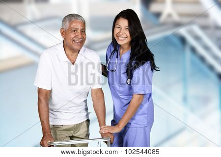 Nurse giving physical therapy to an elderly patient