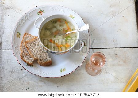 Soup With Macaroni And Vegetables Submitted To A Soup Tureen ?? A Vodka Wine-glass