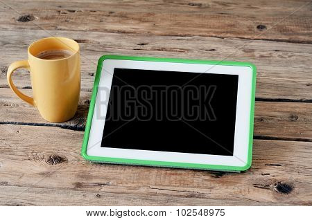 Tablet Computer With Coffee Cup