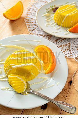 custard pudding with vanilla sauce and orange