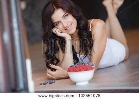 Home portrait of a happy woman with ripe berries