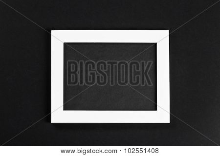 Horizontal White Photo Frame With Black Field On Black Background Isolated With Real Shadows