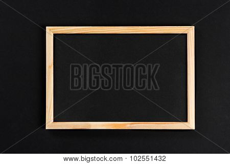 Horizontal Wooden Photo Frame With Black Field On Black Background Isolated With Real Shadows