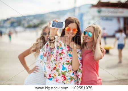 Selfie on memory on the promenade of two female friends