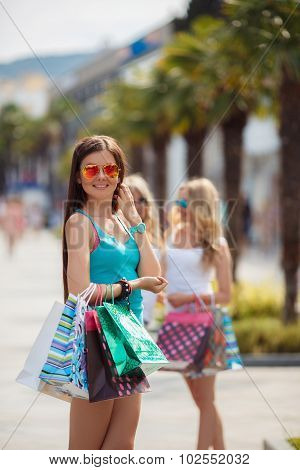 Summer portrait of a woman with colored bags