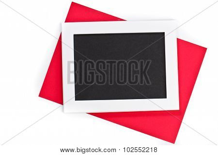 Horizontal White Photo Frame With Black Field And Red Paper Under Angle On White Background Isolated