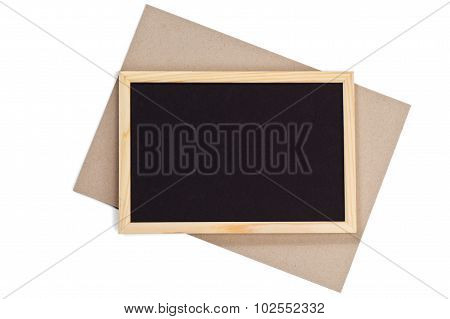 Horizontal Wooden Photo Frame With Black Field And Craft Paper Under Angle On White Background Isola