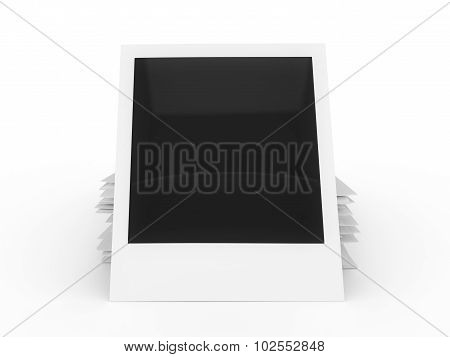 Blank instant photo stack isolated on a white background.