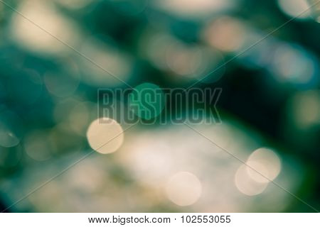 Abstract Blur Bokeh Defocused Of Light In City  Green Yellow Split-tone Background