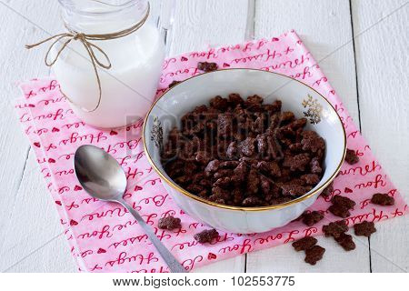 Cereal Chocolate Balls In A Bowl And Milk Jug