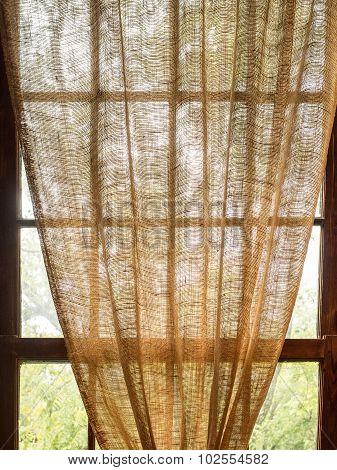 Burlap Curtain Hanging in Sunny Window