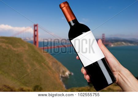 Hand holding a bottle of wine in San Francisco